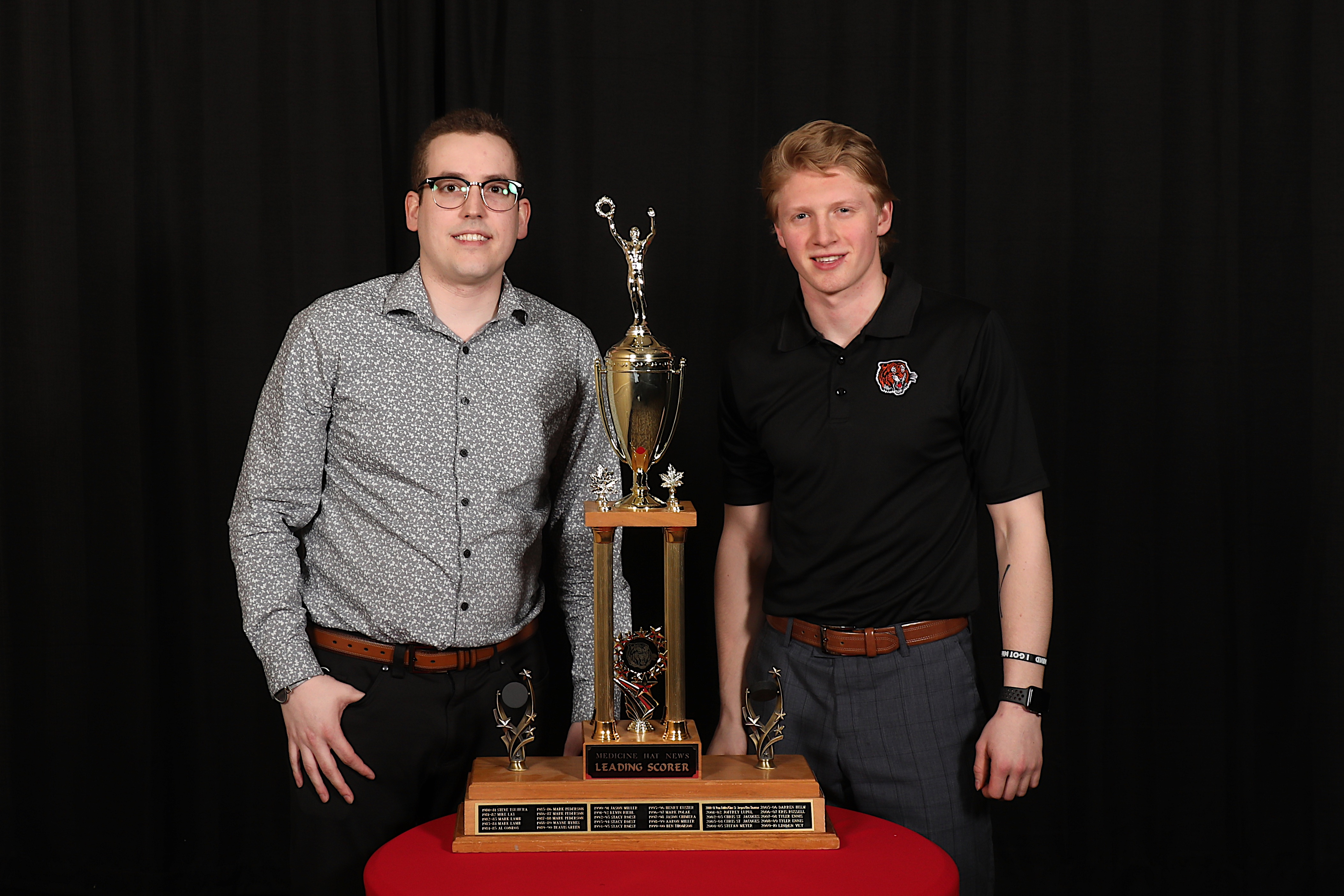 Ryan McCracken of the Medicine Hat News presents the Medicine Hat News Leading Scorer Award to James Hamblin