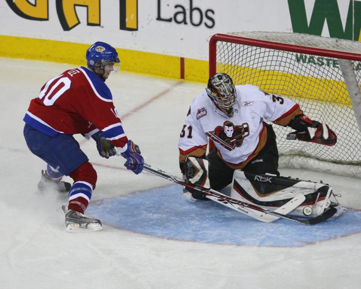 Calgary Hitmen goaltender Martin Jones makes a save on an Edmonton Oil King player during the 2008-09 WHL season. Photo: Calgary Hitmen