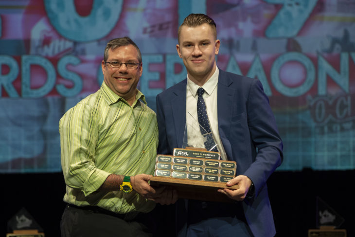 """KELOWNA, BC - MARCH 17: Michael """"Fish"""" Topolniski of GSL Group presents Kyle Topping #24 of the Kelowna Rockets with the Plus/Minus award at the annual Kelowna Rockets awards ceremony at Kelowna Community Theatre on March 17, 2019 in Kelowna, Canada. (Photo by Marissa Baecker/Shoot the Breeze)"""