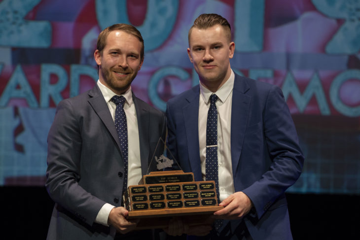 KELOWNA, BC - MARCH 17: Patrick Bobyn of Pushor Mitchell presents the Top Scorer award to Kyle Topping #24 of the Kelowna Rockets at the annual Kelowna Rockets awards ceremony at Kelowna Community Theatre on March 17, 2019 in Kelowna, Canada. (Photo by Marissa Baecker/Shoot the Breeze)