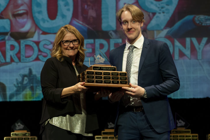 KELOWNA, BC - MARCH 17: Ev Rea of CapriCMW presents Lassi Thomson #2 of the Kelowna Rockets with the Rookie of the Year award at the annual Kelowna Rockets awards ceremony at Kelowna Community Theatre on March 17, 2019 in Kelowna, Canada. (Photo by Marissa Baecker/Shoot the Breeze)