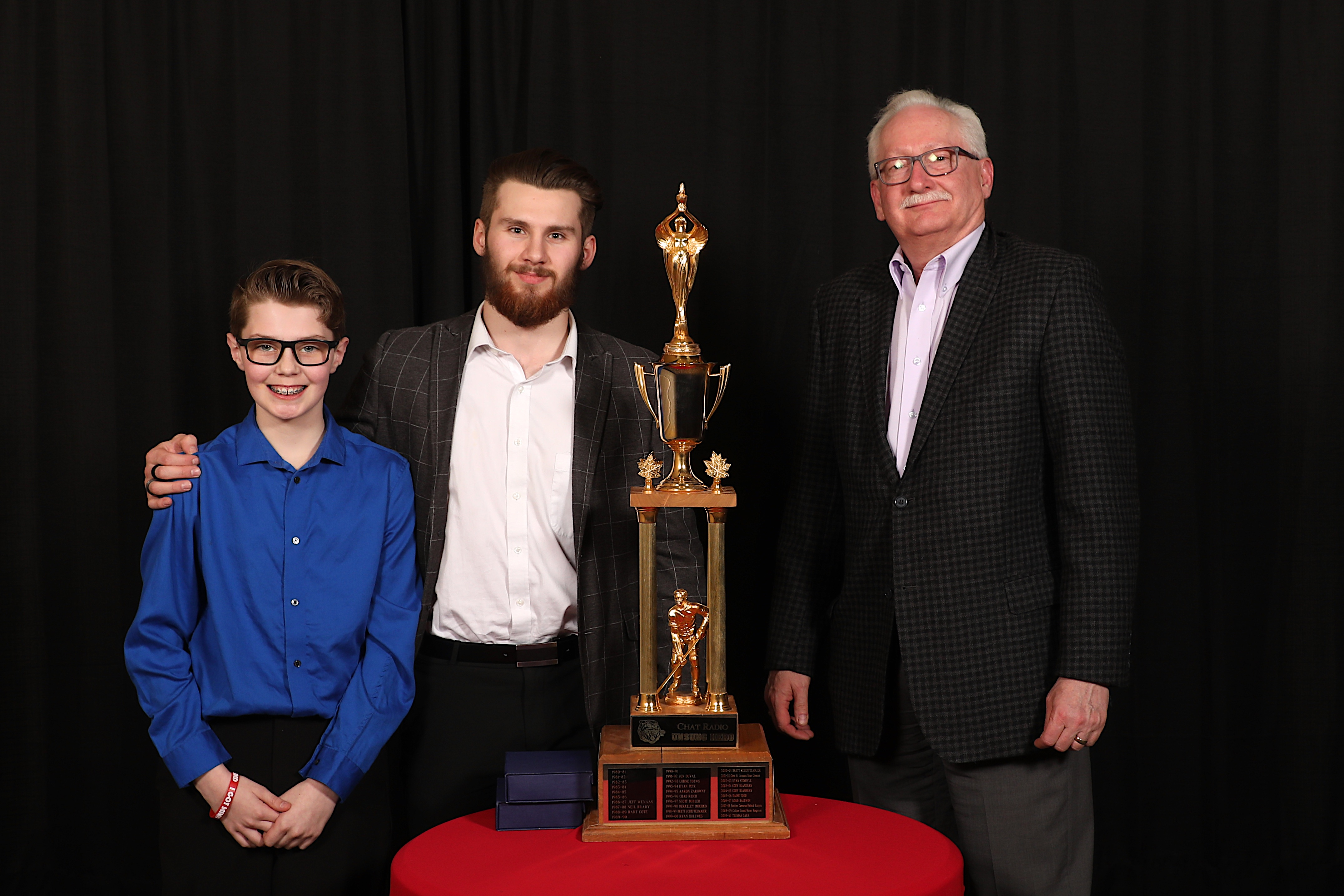 Dave Sherwood of the Jim Pattison Broadcast Group presented Ryan Jevne & Dylan MacPherson with the Chat 94.5 Unsung Hero Award (Landon MacPherson accepted on Dylan's behalf)