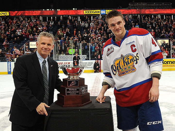 WHL Commissioner Ron Robison presents Edmonton Oil Kings captain Keegan Lowe with the Eastern Conference Championship trophy in the 2013 WHL Playoffs. Photo: Edmonton Oil Kings.