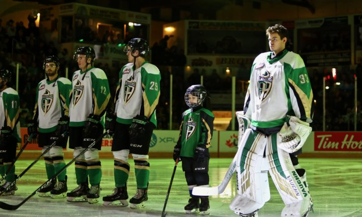 Goaltender Ian Scott of the Prince Albert Raiders lines up with teammates before puck drop. Photo: Lucas Chudleigh/Apollo Multimedia